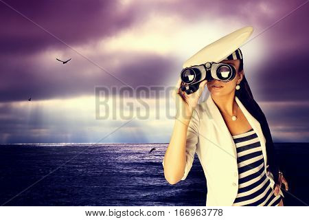 Girl with binoculars in white jacket .