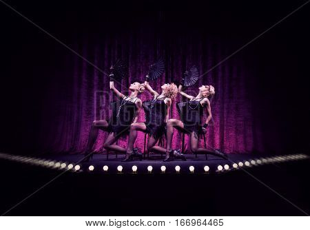 Three fabolous girls on the violet stage.