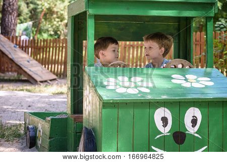 Two Little Brother Toddlers Playing With Toy Car In Summer Garden. Boys Having Fun And Good Time. In