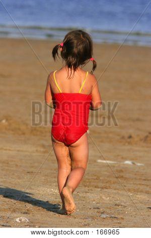 Child Wandering Towards The Sea