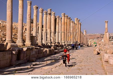 JERASH, JORDAN - NOVEMBER 5, 2010: The archeological site of Jerash with children having fun