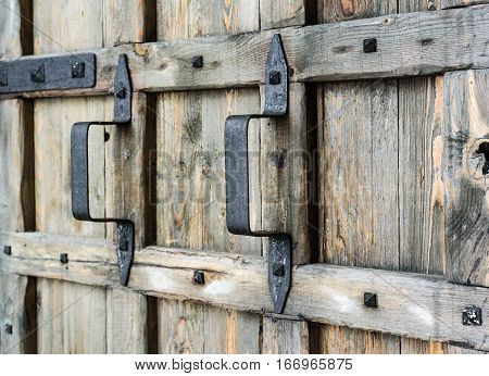 old vintage wooden gate with wrought iron handles