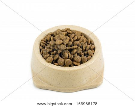 The close up of kibbles (dog food) in brown plastic dog bowl.