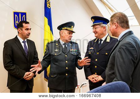 Záhony Hungary - January 25 2017: Head of the State Borderguard Service of Ukraine colonel general Viktor Nazarenko (C) and the deputy police chief - chief of law enforcement of Hungary major general Zsolt Halmosi (R2) communicate during the opening of th