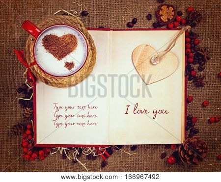 Valentine's Postcard. Cup Of Coffee On Open Book With Wooden Heart On It.