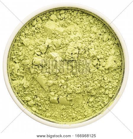 matcha green tea powder in a ceramic round  bowl isolated on white