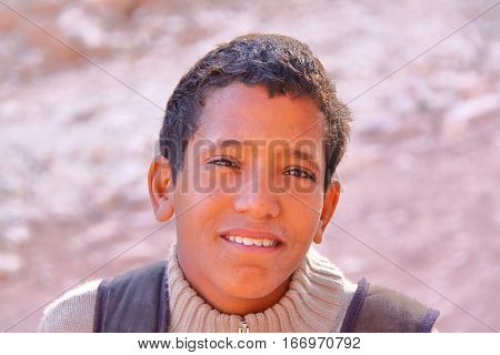 PETRA, JORDAN - NOVEMBER 17, 2010: Portrait of a  young bedouin boy