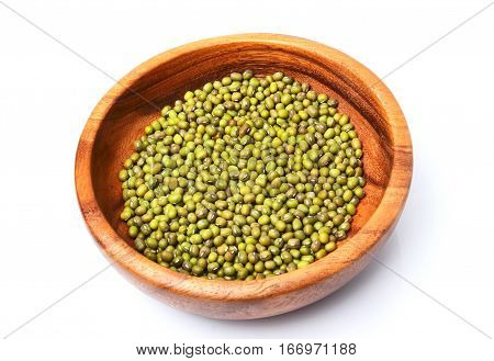 Raw mung bean in a wooden plate.Isolated on a white background.