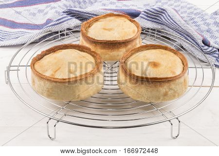 warm scottish pie on a cooling rack