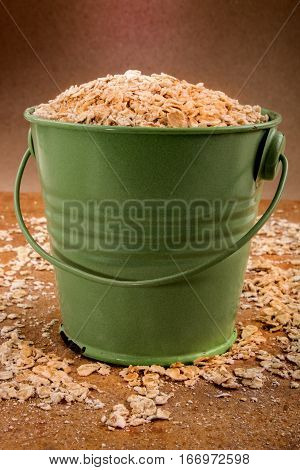 old green bucket filled with fresh scottish oatmeal