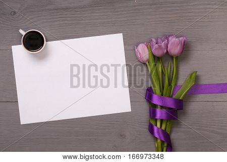 Lilac tulips and coffee with banner space for text in the lilac wooden table. Banner template layout mockup for Woman Day, Valentines Day and Teacher's Day. Photo for posts, blogs, advertising and news.