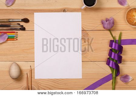 Lilac  tulip and coffee with biscuits in the wooden table of the artist. Banner template layout mockup for Woman Day, Valentines Day and Teacher's Day. Photo for posts, blogs, advertising and news.