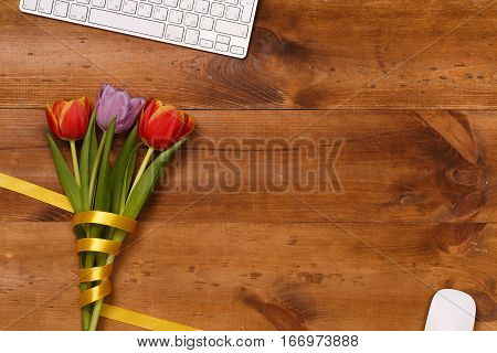 Lilac and red tulips  in the wooden table. Banner template layout mockup for Woman Day, Valentines Day and Teacher's Day. Photo for posts, blogs, advertising and news.