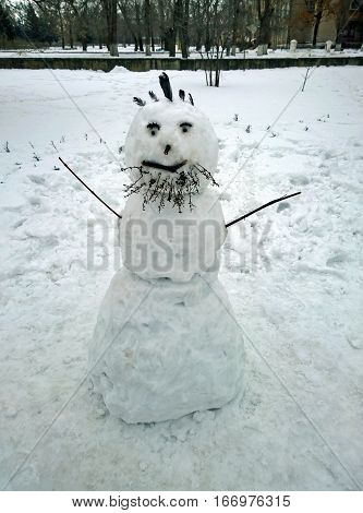 Funny snowman with a beard made by children in the city of Krivoy Rog in Ukraine