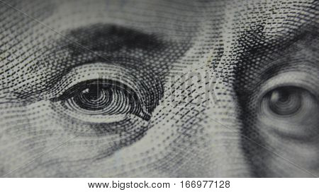 Eyes of Benjamin Franklin. One hundred dollars