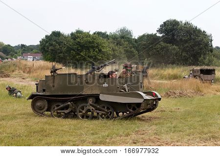 WESTERNHANGER, UK - JULY 24: A WW2 Universal Bren carrier takes position at the edge of the battlefield during a re-enactment at the War & Peace revival show on July 24, 2015 in Westernhanger