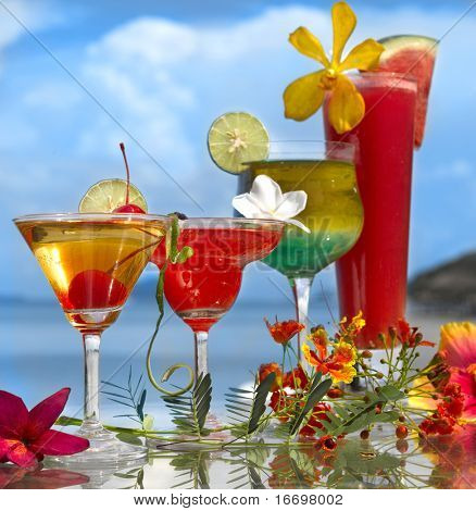 four cocktails on the beach