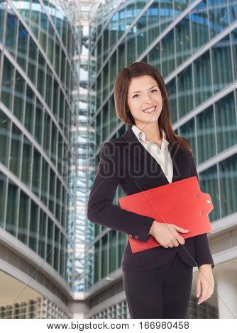 real estate agent in front of a building