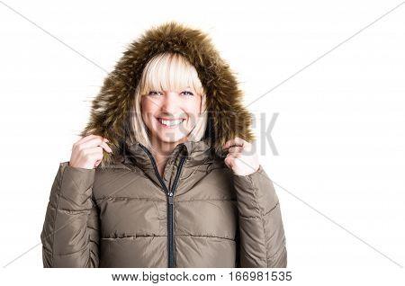 Portrait Of Cute Lady Holding Winter Furry Hood