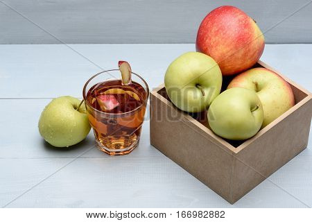Glass With Juice, Pieces Of Apple, Cinnamon, Box With Apples