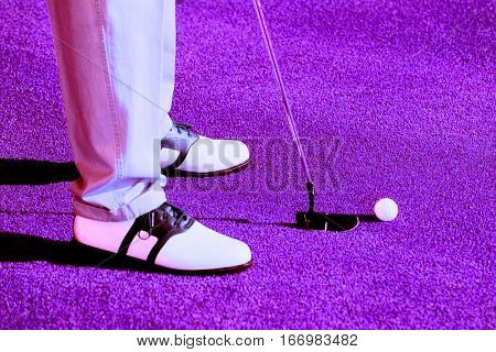 Golfer Preparing to Putt for Par