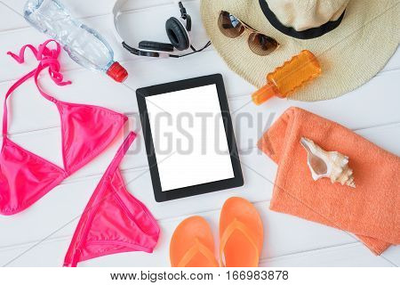 Tablet and sunbathing kit for women going on vacation