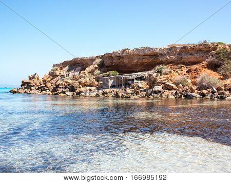 Cala Saona Beach Boathouses