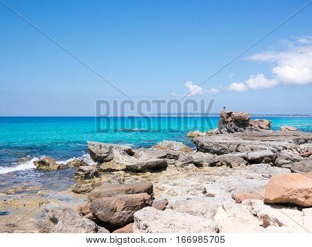 A Girl meditating in Formentera island, Spain