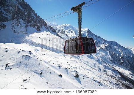 Chamonix, France: Cable Car from Chamonix to the summit of the Aiguille du Midi. poster