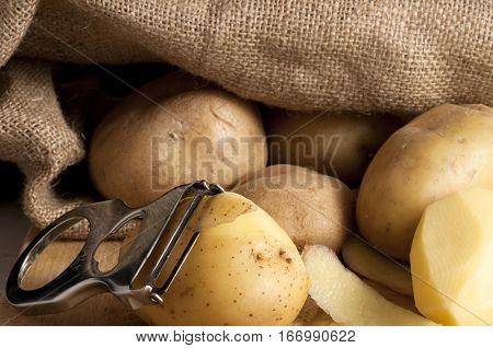 potatoes outside a jute sack , food