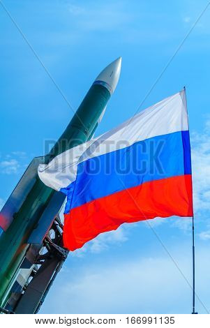 Developing a Russian flag on a background of rocket launchers.