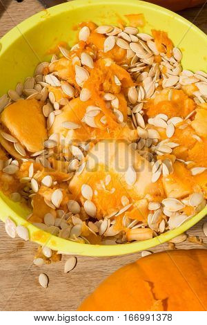 Pumpkin Pulp And Seeds In A Lime Green Bowl