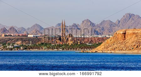 View from the sea on the minarets of the new mosque in Sharm El Sheikh .