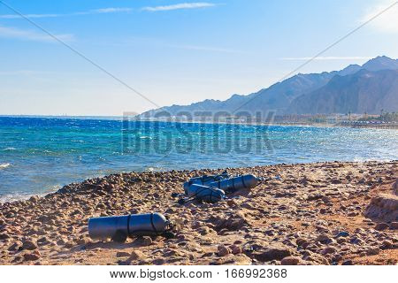Stage cylinders on the rocky beach of the red sea. Dahab.