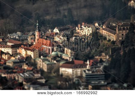 city ​​in miniature at sunset, Baden-Baden from a height, the red roofs of the town in Germany, the old city, cityscape