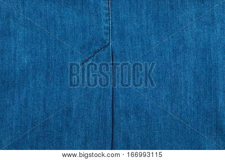 Jeans texture with seams. Blue seam on blue denim. Background texture