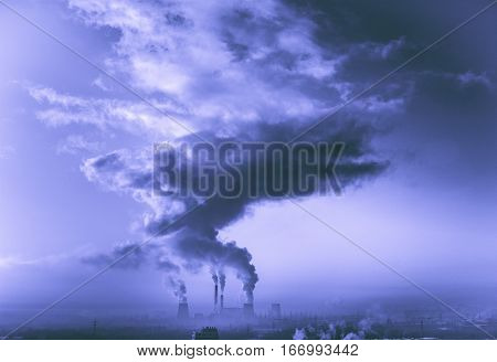 View in thermal power plants. Through the large clouds punched sunlight.
