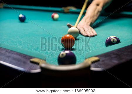 man playing billiard. Lucky combination in billiard. close up