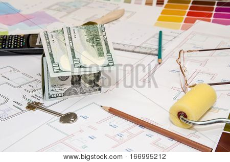 dollar banknotes as model house on a construction plan for house building