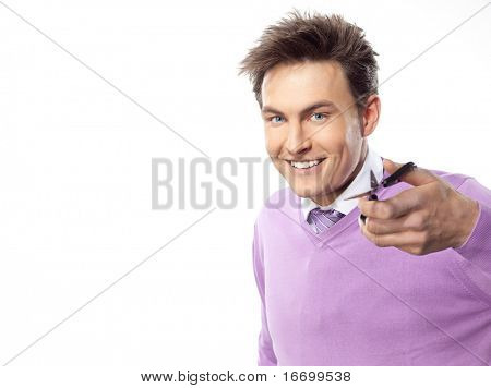 attractive man portrait on white background with scissors