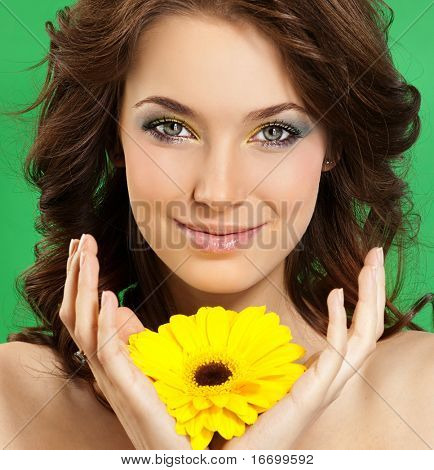 attractive smiling woman portrait on green background poster