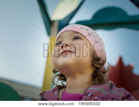 Portrait of a girl 2-3 years. Girl playing on the playground.