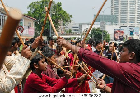 Georgetown Penang Malaysia - 7 February 2009: Youths performing a stick dance involving the rhytmic beating of rattan canes as part of the Thaipusam festival in Penang