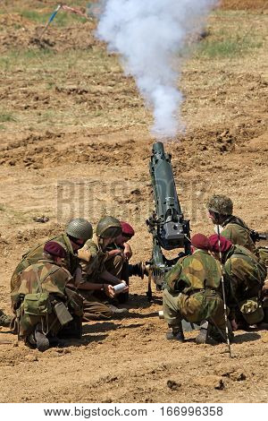 WESTERNHANGER, UK - JULY 18: Members of a Living History group fire their artillery pieces in the arena to mark the passing of the midday gun at the War & Peace show on July 18, 2014 in Westernhanger