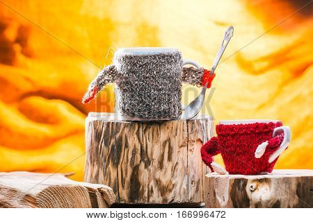 Big tea mug wearing sweater addressing to small cup. Family tea concept