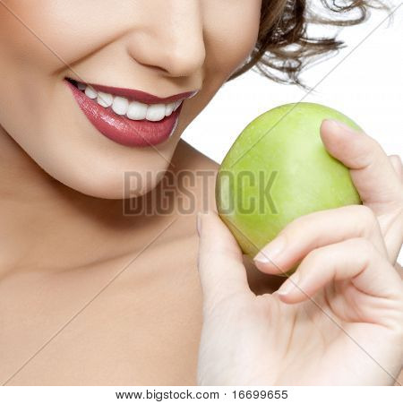attractive smiling woman portrait with appleon white background