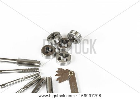 Professional mechanical hand tool set . Tap and die nuts for metal processing.