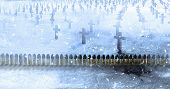 Brass ammunition with a lead bullets row in a cemetery with concrete crosses during the winter snowfall poster