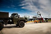 Fighter Mig-29 And Truck at the International Aviation and Space salon MAKS poster