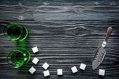 absinthe in glass on wooden background top view mock up. poster